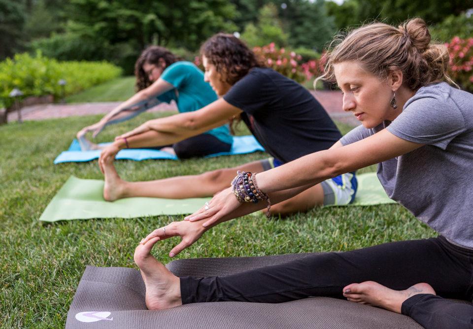 Three guests during a yoga class at Mt. Cuba Center.
