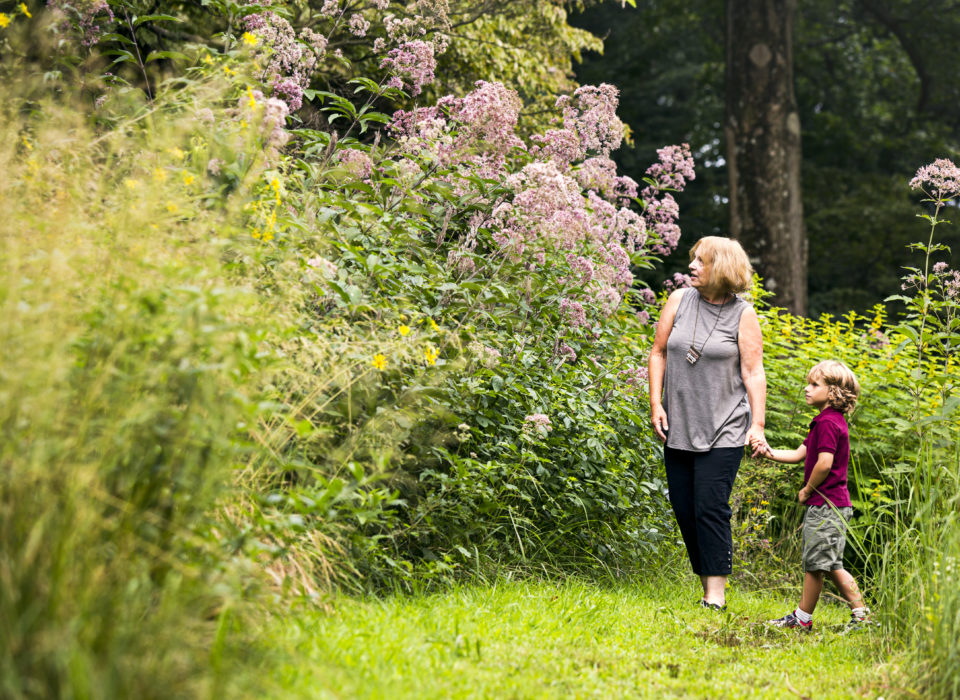 A grandmother and grandson explore the gardens at Mt. Cuba Center.