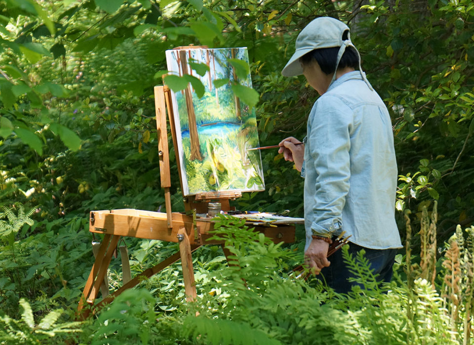 Artist painting en plein air at the Spring Art-In