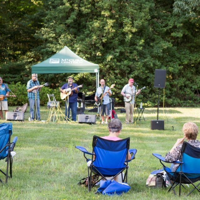 Guests enjoy a concert on the lawn at Mt. Cuba Center.