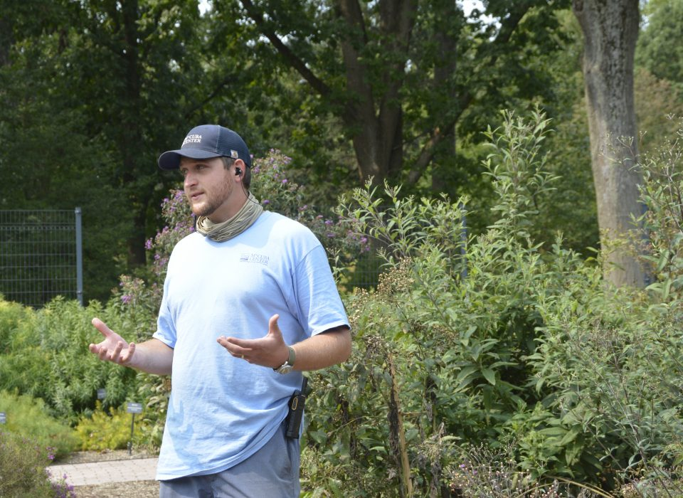 Manager of Horticultural Research, Sam Hoadley, gives a talk in a garden